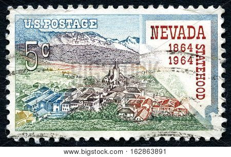 UNITED STATES OF AMERICA - CIRCA 1964: A postage stamp from the USA celebrating the 100th Anniversary of Nevada Statehood circa 1964.