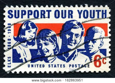 UNITED STATES OF AMERICA - CIRCA 1968: A postage stamp from the USA promoting the message of Supporting our Youth and celebrating the 100th Birthday of Elks Youth Organization circa 1968.
