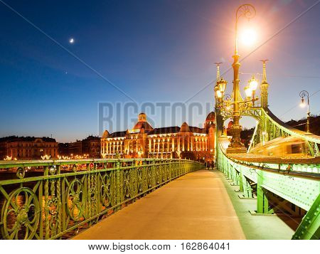 Night shot. of Art Nouveau style historical building of Gellert spa on the bank of Danube River in Budapest, capital city of Hungary, Europe. Evening view from Liberty Bridge.