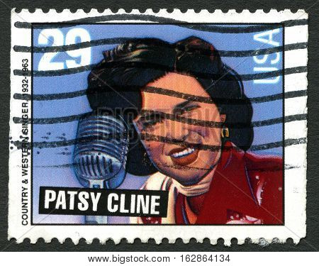 UNITED STATES OF AMERICA - CIRCA 1993 - A used postage stamp from the USA depicting a portrait of famous American Country Singer Patsy Cline circa 1993.