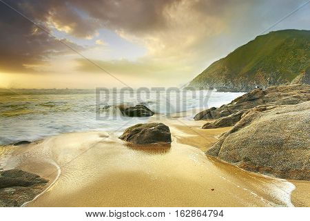 A big pacific storm churned up the ocean into a sea of spray and mist just as the sun was setting. Here the waves have settled down a bit relefting a peaceful feeling. At other moments it was anything but peaceful as the surf pounded the beach with surges