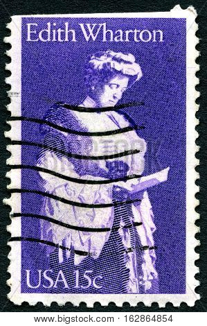 UNITED STATES OF AMERICA - CIRCA 1980: A used postage stamp from the USA depicting a portrait of Edith Wharton - American novelist and writer circa 1980.