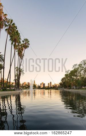 Sunset golden hour view of Los Angeles downtown at Echo Park Lake