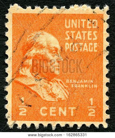 UNITED STATES OF AMERICA - CIRCA 1938: A used postage stamp from the USA depicting a portrait of Founding Father and former US president Benjamin Franklin circa 1938.