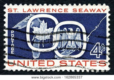 UNITED STATES OF AMERICA - CIRCA 1959: A used postage stamp from the USA celebrating the opening of St. Lawrence Seaway shows Maple Leaf with the American Eagle circa 1959.