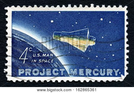 UNITED STATES OF AMERICA - CIRCA 1962: A used postage stamp from the USA dedicated to project Mercury the first flight into space by US astronaut John Glenn circa 1962.