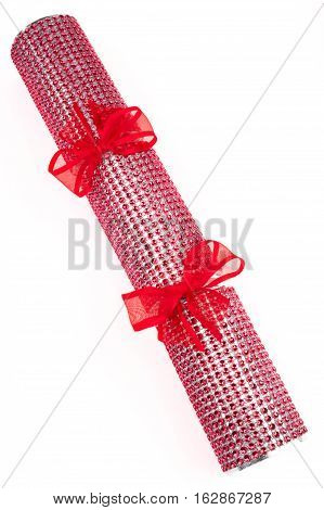 A studio shot of a Crackers or otherwise known as a Bon Bon. A traditional cracker consists of a cardboard tube wrapped in a brightly decorated twist of paper with a gift in the central chamber.