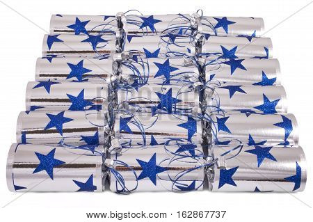 A studio shot of a set of Crackers or otherwise known as Bon Bons. A traditional cracker consists of a cardboard tube wrapped in a decorated twist of paper with a gift in the central chamber.