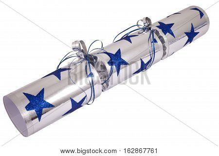 A studio shot of a traditional Cracker or otherwise known as a Bon Bon. A traditional cracker consists of a cardboard tube wrapped in a decorated twist of paper with a gift in the central chamber.
