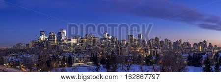 CALGARY, CANADA - DEC 17: Sweeping skyline view at sunset on December 17, 2016 in Calgary, Alberta. Calgary is home to many oil companies. Taken from hill close to SAIT.