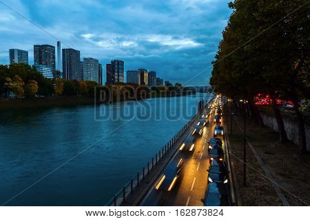 View Along The River Seine In Paris, France, At Night
