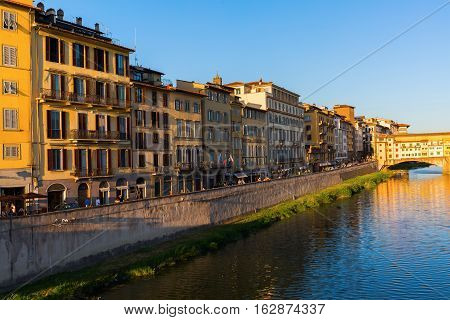 Historical Buildings Along The River Arno In Florence, Italy