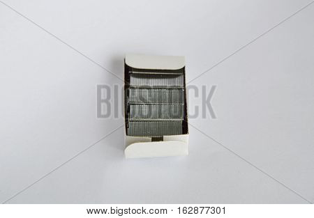 stapler wire in paper box on white background