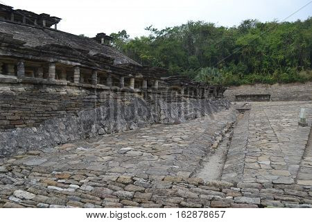 Ruins and drainage canals during a thunderstorm at the pre-Columbian archeological site El Tajin in Papantla, Veracruz, Mexico