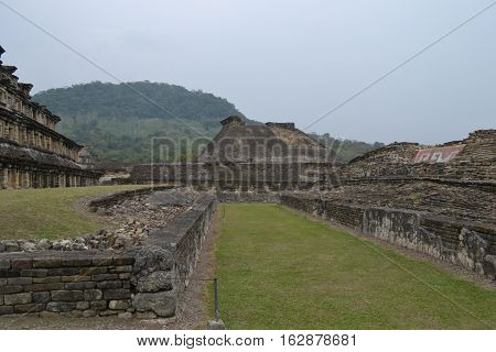 Ruins and pyramids during a thunderstorm at the pre-Columbian archeological site El Tajin in Papantla, Veracruz, Mexico