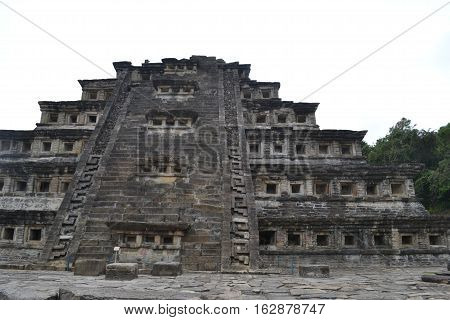 Pyramid of the Niches at the pre-columbian archeological site known as El Tajin located in Papantla, Veracruz, Mexico taken during a thunderstorm