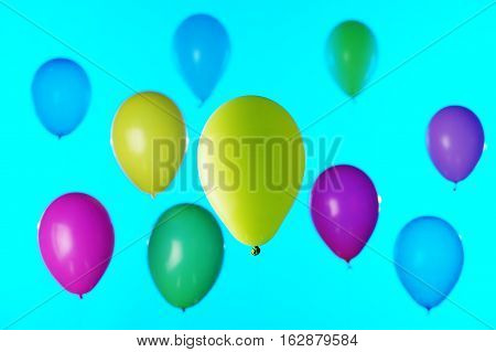 Colorful balloons blured on the blue sky