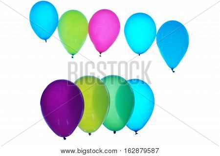 Colorful balloons arranged in two rows on light background