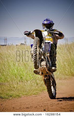 Motocross Rider On Back Wheel