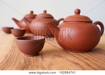Chinese teapot and teacup on spruce wood