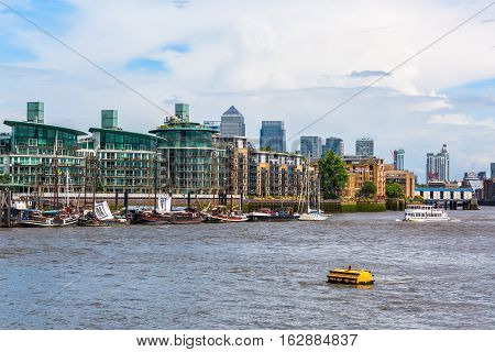 View Over The Thames To The Docklands With The Canary Wharf In London, Uk