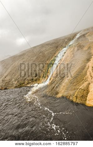 Runoff from a thermal spring in Midway Geyser Basin flows into the Firehole River in Yellowstone National Park