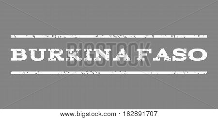Burkina Faso watermark stamp. Text tag between horizontal parallel lines with grunge design style. Rubber seal stamp with dirty texture. Vector white color ink imprint on a gray background.