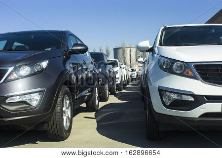 A Row Of New Cars Parked At A Car Dealer Shop