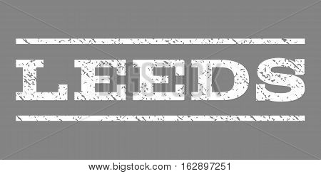 Leeds watermark stamp. Text caption between horizontal parallel lines with grunge design style. Rubber seal stamp with scratched texture. Vector white color ink imprint on a gray background.
