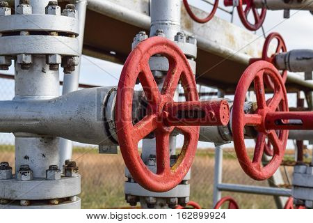 Shut-off valve valve with manual drive. Red steering wheel lock gate valve. oil well equipment.
