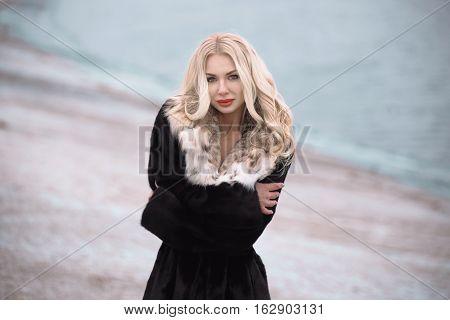 Beautiful Young Girl In A Fur Coat