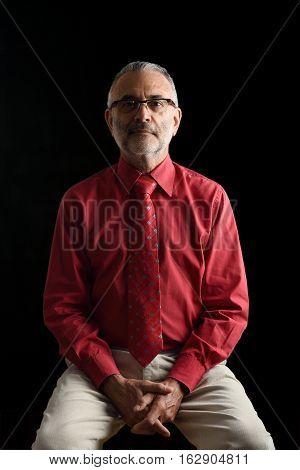 Portrait of  elegant mature man on black
