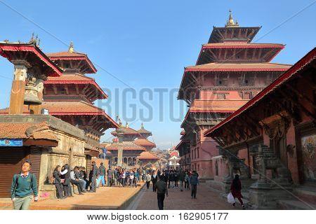 PATAN, NEPAL - DECEMBER 19, 2014: The main street along the temples at Durbar Square
