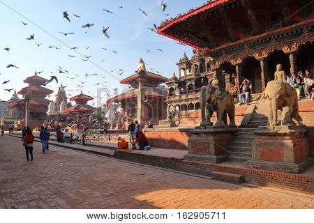 PATAN, NEPAL - DECEMBER 19, 2014: The main street in the early morning along the temples at Durbar Square