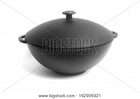 High Angle View On The Closed Clean Empty Cast Iron Pan Isolated On White Background Close-up