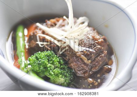 stewed beef stewed pork with vegetable dish