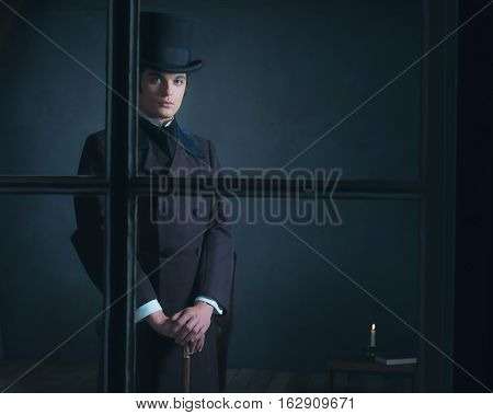 Dickens Style Man Standing With Cane Behind Window.