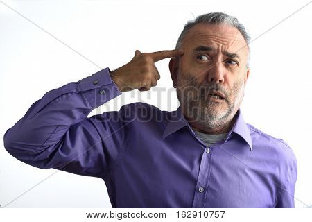 A man shooting with a finger on his head with white background
