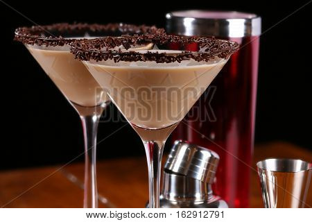 Chocolate martini garnished with chocolate powder and sprinkles on the rim