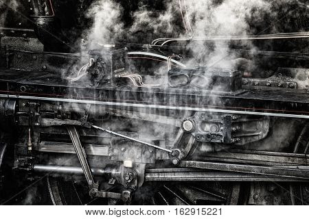 Stunning grunge detailed close up of vintage steam train wheels and rods and mechanics