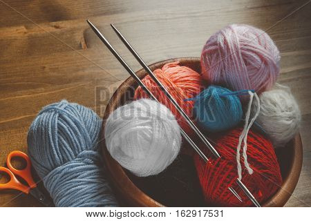 Colored thread for knitting with spokes plastic needle and scissors
