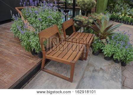 Two wooden chair in the garden .