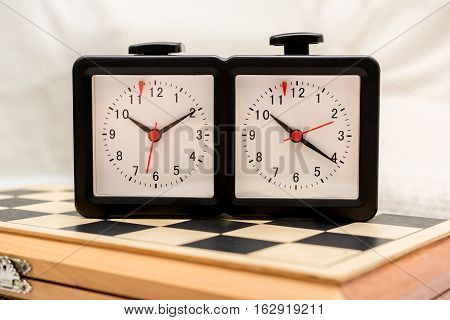 Chess boards and chess clocks. For the game of chess.