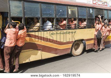 Illustrative image. Pondicherry Tamil Nadu India - June 25 2014. Bus full with indian school boys and girls children dangerous on road