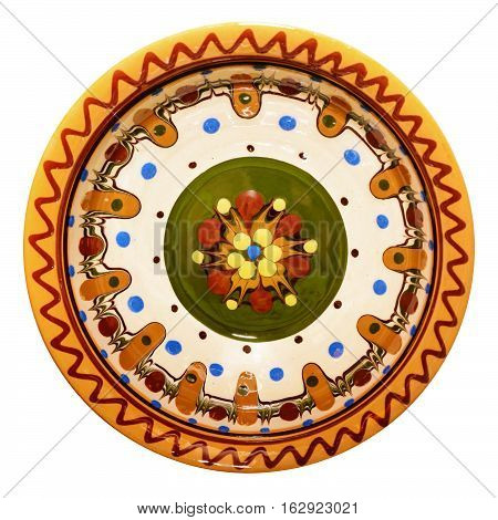 Traditional colored pottery. Painted ceramic plate. Isolated, white background. poster