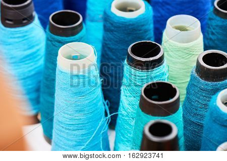 The set of spools of sewing thread
