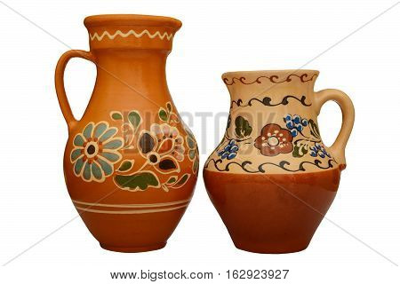 Traditional colored pottery. Painted ceramic jugful. Isolated, white background.