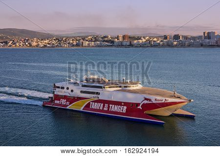 Tanger, Morocco - May 3, 2016: Hydrofoil ship in Tanger Morocco sailing along seaside