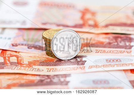 Russian currency rouble: banknotes and coins close up