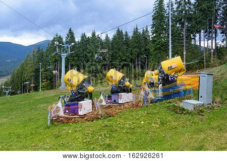 Snow gun. Snow making machine. Machine that makes artificial snow and blows it onto ski slopes.